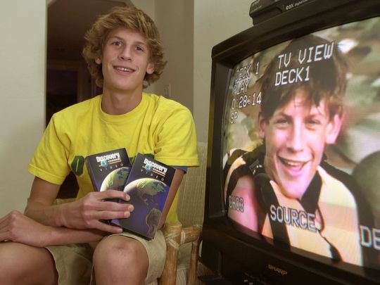 Charlie Keating at age 15 in front of a TV recording of a TV show he was on
