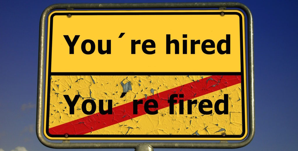 "A road sign with ""You're hired"" and ""you're fired"" written on it"